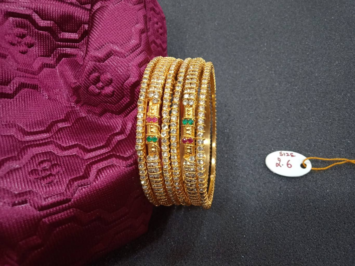 white stone bangles models online with price